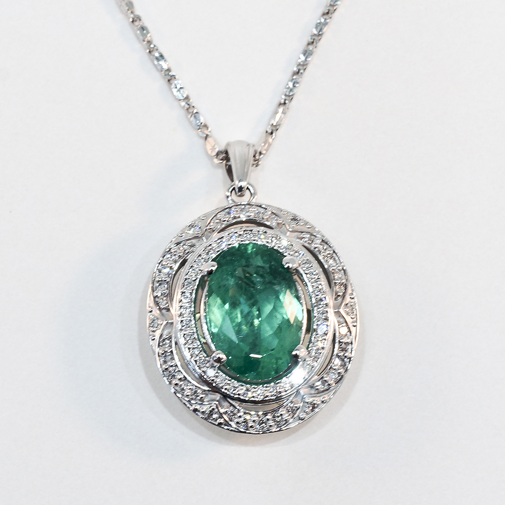 14k White Gold Emerald And Diamond Pendant Shown With