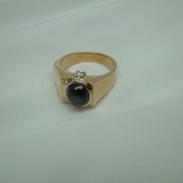 Gent's 14K Two-Tone Black Star Sapphire And Diamond Ring featured